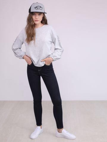 מכנסי ג'ינס סקיני מותן גבוהה