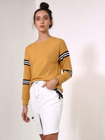 חצאית ג'ינס לבנה עם שרוכים