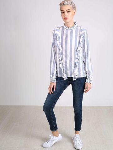 סקיני ג'ינס עם רוכסנים בסיומת