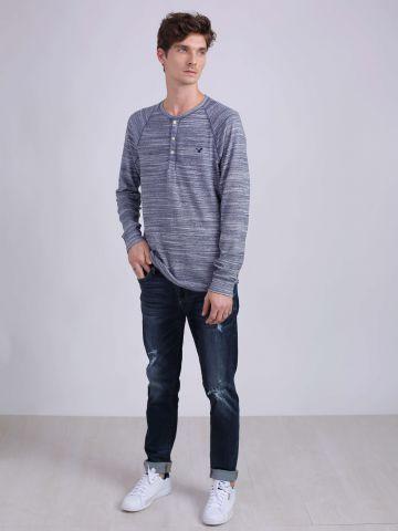 מכנסי ג'ינס סקיני קרעים