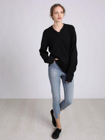 מכנסי ג'ינס סיומת אסימטרית Donna Dollar