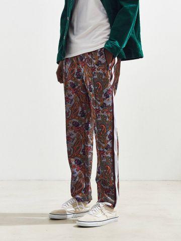 מכנסי טראק רחבים בהדפס פייסלי UO