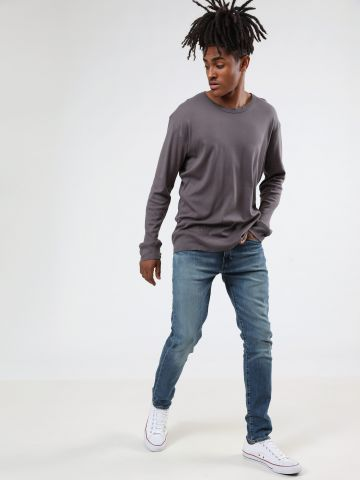 ג'ינס סקיני בשטיפה בהירה עם ווש