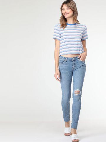 ג'ינס סקיני בשטיפה בהירה עם קרעים 711
