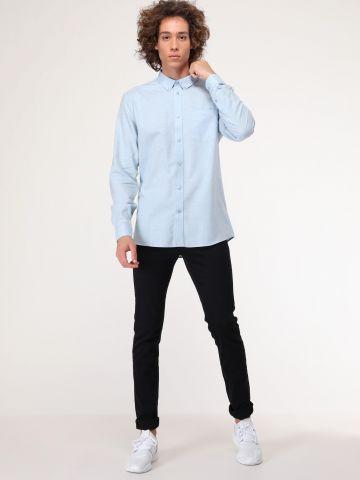 חולצה מכופתרת עם כיס בחזית