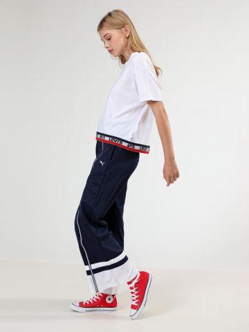 מכנסי טראק מתרחבים עם סיומת מודגשת