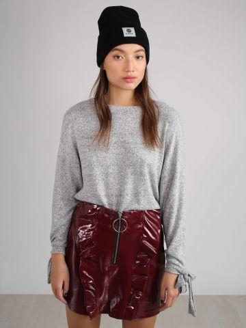 חצאית וייניל עם מלמלה