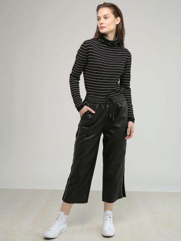 מכנסיים דמוי עור עם פס קטיפה