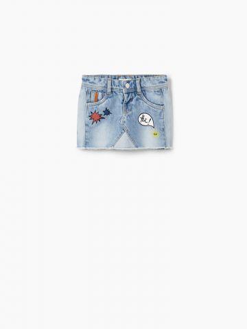 חצאית ג'ינס עם סיומת פרומים