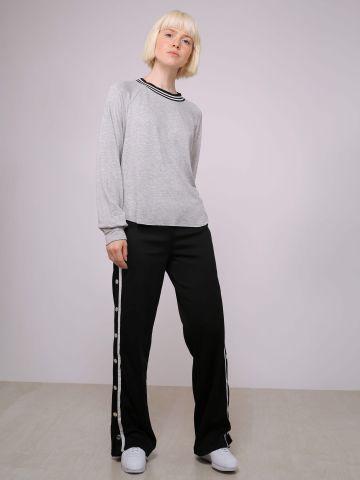 מכנסי טרנינג בגימור מבריק עם תיק-תקים