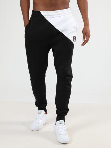 מכנסי טרנינג קולור בלוק לוגו