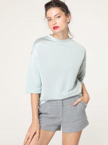 מכנסיים קצרים בהדפס משבצות עם מלמלה