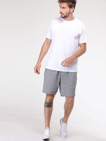 מכנסי טרנינג בהדפס ווש