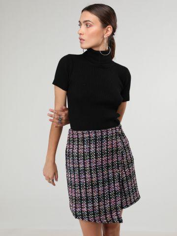 חצאית סרוגה צבעונית סיומת אסימטרית