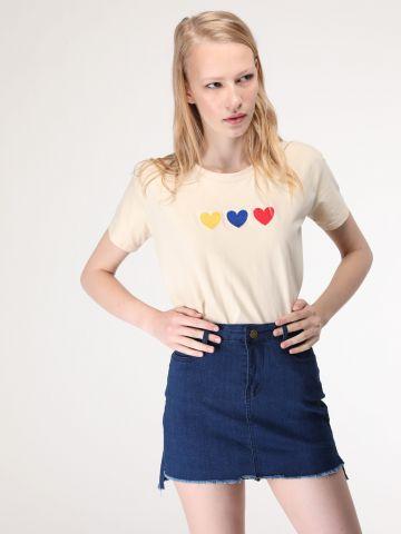חצאית ג'ינס מיני עם סיומת אסימטרית פרומה