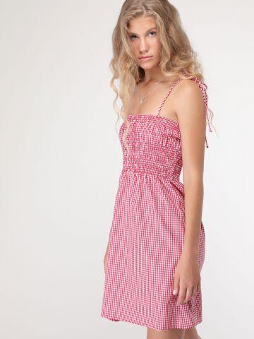 שמלת משבצות מיני עם כיווצי גומי וכתפיות נקשרות