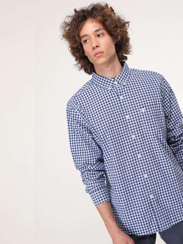 חולצה מכופתרת משבצות עם כיס בחזית