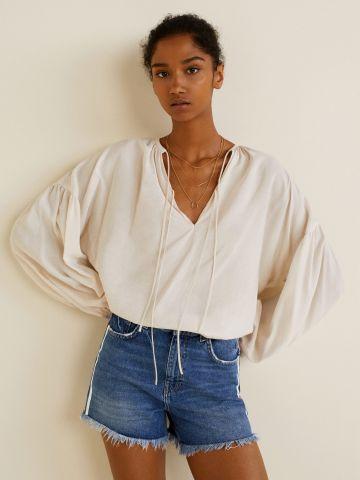 ג'ינס קצר עם סטריפים בצדדים