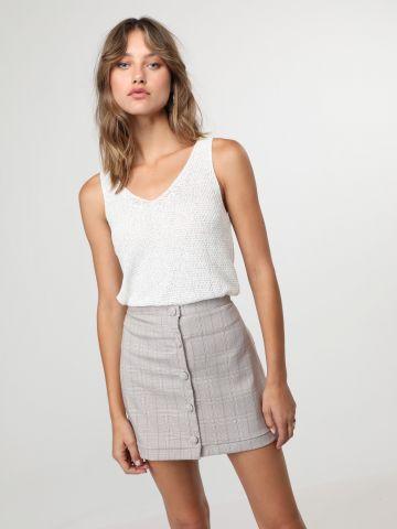 חצאית מיני משבצות עם כפתורים