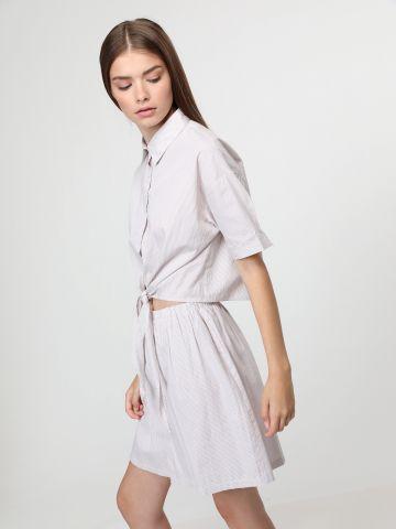 חצאית מיני פסים בשילוב כפתורים