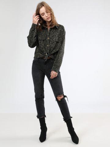ג'ינס סקיני נמוך עם קרעים וסיומת פרומה