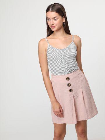 חצאית מיני פשתן בשילוב כפתורים בחזית