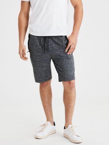 מכנסי טרנינג קצרים עם לוגו רץ / גברים