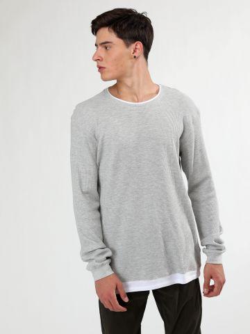 חולצה בטקסטורת פיקה עם סיומת בד כפולה