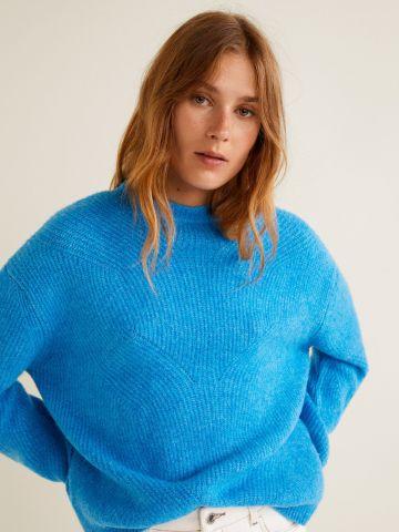 סוודר בטקסטורות משתנות