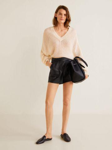 מכנסיים קצרים דמוי עור עם תפרים קונטרסטיים