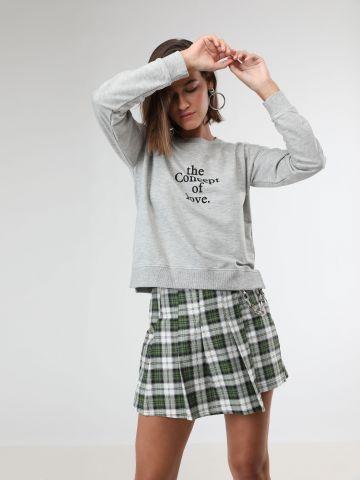 מכנסי חצאית בהדפס משבצות עם שרשרת