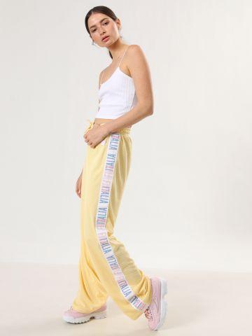 מכנסי רשת עם סטריפים לוגו