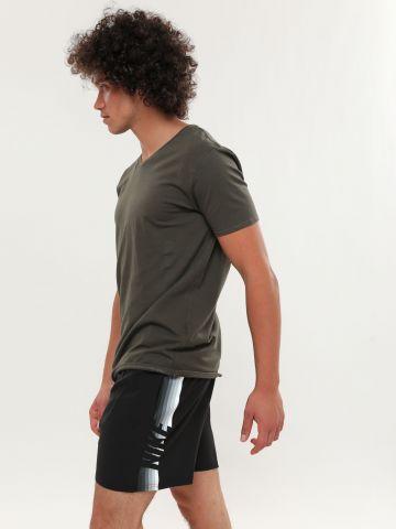 מכנסי בגד ים עם הדפס פסים לוגו