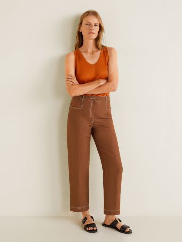 מכנסיים בשילוב פשתן עם תיפורים קונטרסטיים