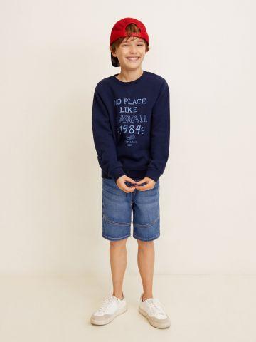 ג'ינס קצר עם ווש ותפרים בולטים