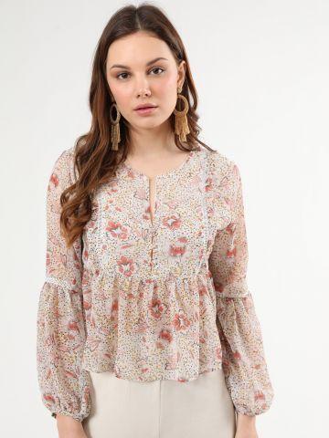 חולצת פפלום פרחונית בעיטור פסי רשת ומלמלה