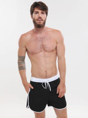 מכנסי בגד ים לוגו
