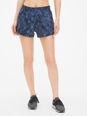 מכנסי ריצה קצרים בהדפס פרחים / נשים